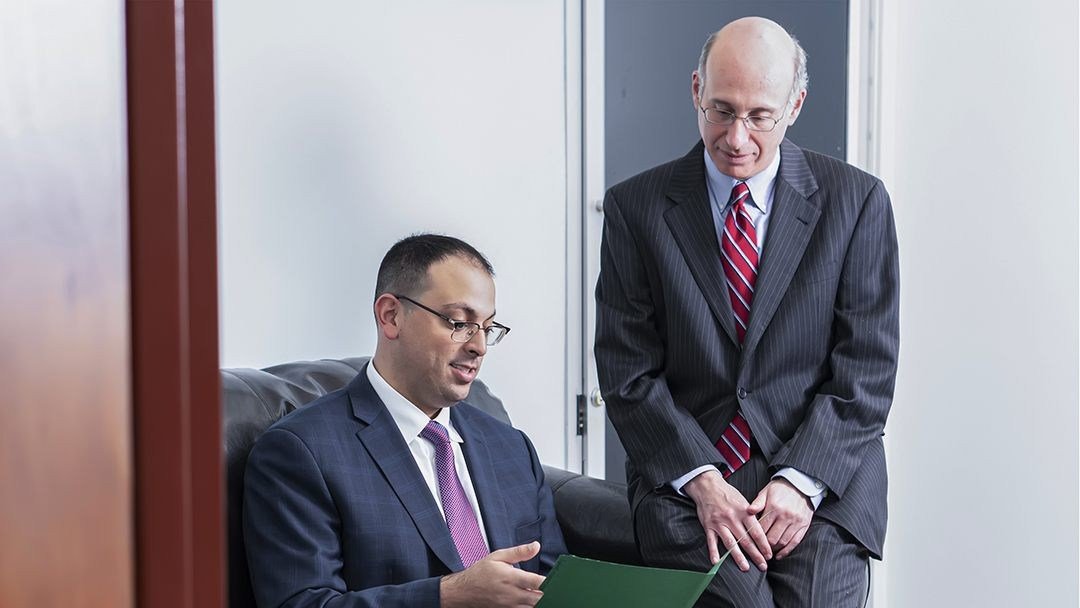 2 lawyers reviewing medical malpractice case for NY client