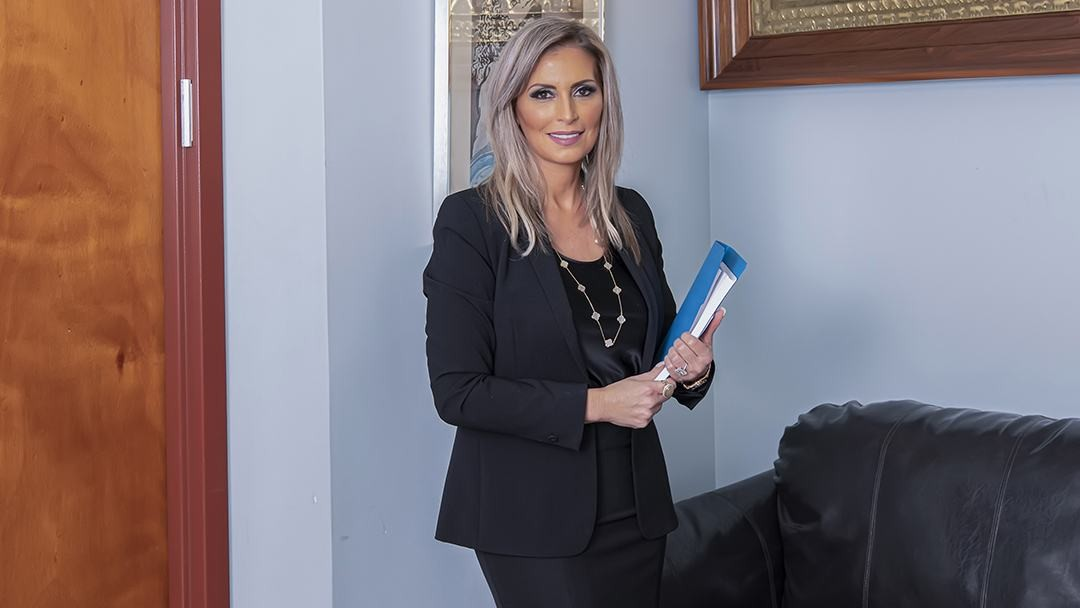 Daniella Levi in the Queens law firm office