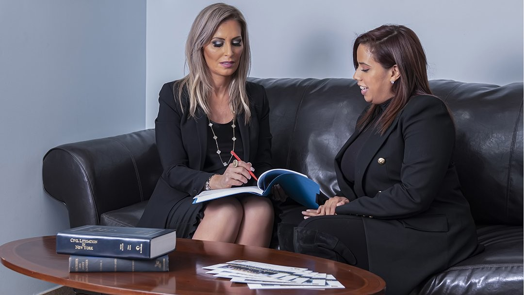 lawyer and staff reviewing client case details