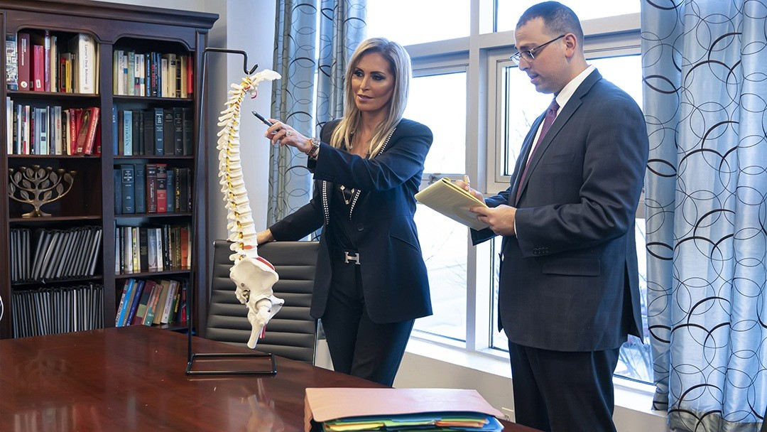 discussing vehicle accident case and client injuries